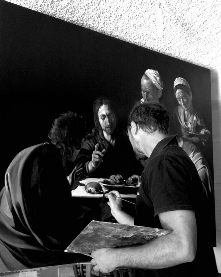 """Massimo Tizzano working on his painting """"The Supper in Emmaus."""""""