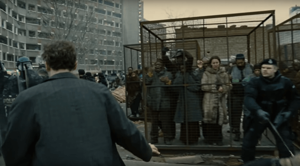A screenshot of the refugee cages from the theme setting first minutes of the film.